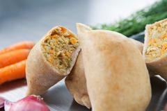 Empanadas (Latin American pasties) filled with a mixture of cooked maize, Stock Photos