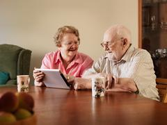 Older couple using tablet computer Stock Photos