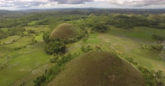 Aerial swoop around chocolate hills in Bohol, Philippines Stock Footage