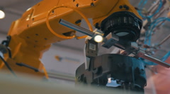 Industrial robot hand performs movements that are programmed in the control unit Stock Footage