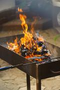Fire, flames from wood ember for grill or bbq picnic - stock photo