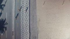 Flying above Ipanema Beach mosaic sidewalk and street, Rio de Janeiro Stock Footage