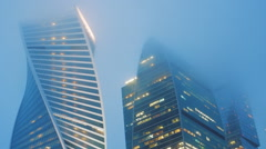 Beauty evening Moscow City in the fog in the upper floors Stock Footage
