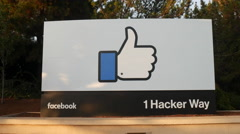 Facebook Headquarters Sign in Palo Alto, California with the setting sun Stock Footage