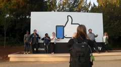 Facebook Headquarters Sign with people posing for a photo Stock Footage