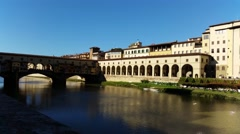 Florence, Italy Ponte Vecchio arch bridge over the river Arno. Stock Footage