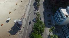 Aerial view of Ipanema Beach mosaic sidewalk and street, Rio De Janeiro Stock Footage