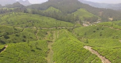 Aerial shot, following countours of hills in Munnar, India Stock Footage