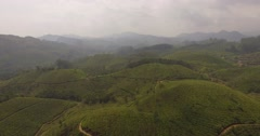 Aerial shot, moving down over hills in Munnar, India Stock Footage