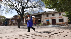 Villager walking on a village square after shopping in bazaar Stock Footage