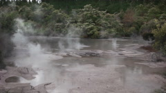 Wide view of a boiling mud pool Stock Footage