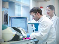 Stock Photo of Scientists conducting the process of Polymerase chain reaction (PCR) to amplify