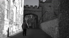Lincoln England woman walk Bishops house BW 4K Stock Footage