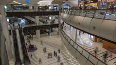 Time lapse of people walking through shopping mall in Hong Kong Stock Footage