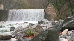 Artificial waterfall on the river  Termopotamos Stock Footage
