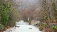 Artificial waterfall on the river  Termopotamos. 4К Stock Footage