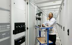 Businessman using computer with servers Stock Photos