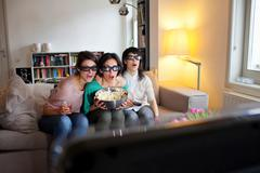 Women watching 3D movie together Stock Photos