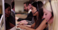 4k, Stock traders wearing headsets busy working on their computer. Slow motion. - stock footage