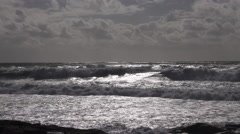 rough sea with waves crashing at sunset in France - stock footage