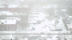 Heavy snowfall in the city in slowmotion. Streets, houses and machine Snowy Stock Footage