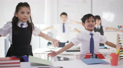 4K Happy group of Asian children doing physical exercises in school classroom Stock Footage