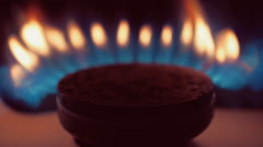 Consecutive ignition of the gas from the burner gas kitchen stove. Macro - stock footage