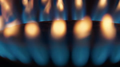 Burning gas in a kitchen stove. The camera moves around - stock footage
