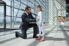 Father arriving in airport with daughter Stock Photos