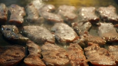 Making of grilled beef  steak on hot plate with smoke Stock Footage