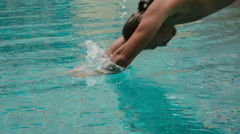 Man diving into a swimming pool Stock Footage