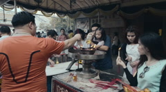 People pour oil at the China Temple - stock footage