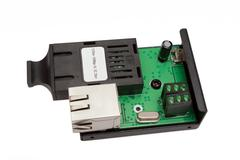 uncovered mini fiber optic Media converter - stock photo