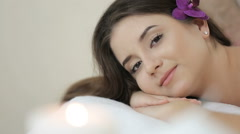 beautiful girl in the massage parlor is looking at the camera - stock footage