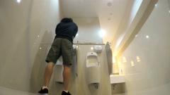 Man's Necessity : Pee in Public Toilet. 4K Stock Footage