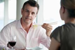 Businessman eating noodles Stock Photos