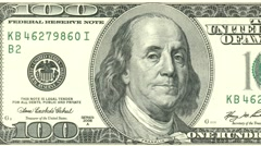 Hundred dollar note obverse dolly shot from left to right showing 100 symbols Stock Footage