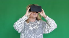 Elderly woman uses VR glasses - 3D - green screen Stock Footage