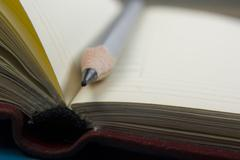 Notepad and pencil macro shot. Copy space for text - stock photo