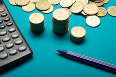 Pen, Money coins stack and calculator for finance concept Stock Photos