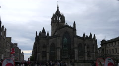 Walking in front of St Giles' Cathedral west facade in Edinburgh Stock Footage