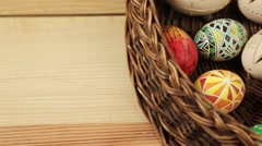 Easter eggs rolling around text Happy Easter Stock Footage