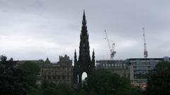 Scott Monument and cranes in Edinburgh Stock Footage