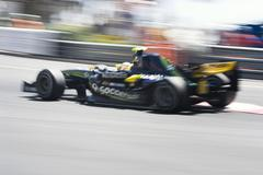 Formula 1 car with motion blur Kuvituskuvat