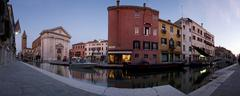 Panoramic view of Venice canal and architecture at dusk - stock photo