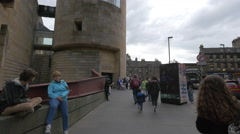 People walking and standing next to the National Museum of Scotland, Edinburgh Stock Footage