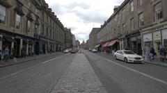 People walking and cars driving on George IV Bridge, Edinburgh Stock Footage