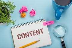Content, online concept. Notepad with message, pen, coffee cup and flower Stock Photos