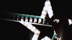 Girl looks through camera roll fefef - stock footage