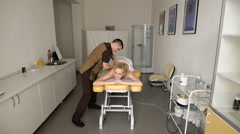 Smiling Young Woman Getting Massage Treatment From Masseuse Stock Footage